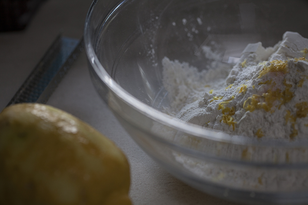 Gluten free flour in mixing bowl with lemon zest on top