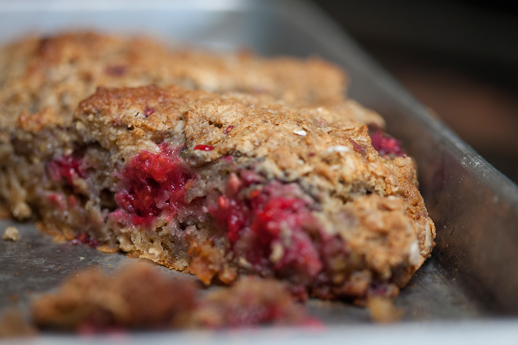 Gluten free raspberry oat scones just out of the oven on baking sheet