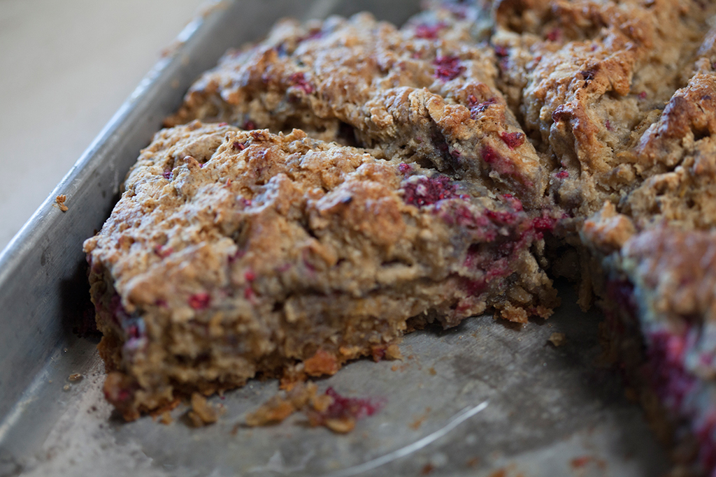 Gluten free raspberry oat scones on baking sheet