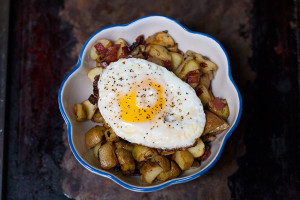 Beach House Hash potatoes with fried egg on top in a bowl