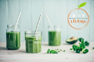DIY Cleanse. Green smoothies in mason jars with straws.